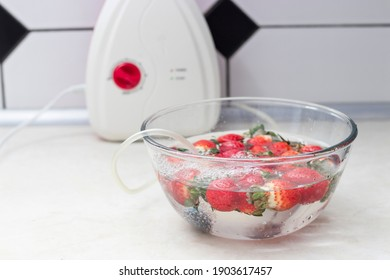 strawberry in a bowl with water with a round ozonating stone. Tubes leading to oxygen pump and ozone generator. ozonation fruit. Food disinfection with ozon - Shutterstock ID 1903617457