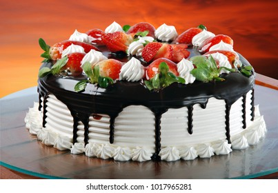 Strawberry cake with chocolate and whipped cream