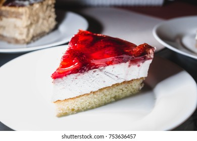strawberry cake on a plate under a bright light. Fruit dessert