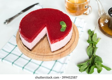 Strawberry cake on table