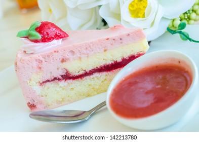 Strawberry cake on white dish