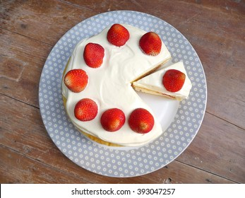 strawberry cake on the wood table