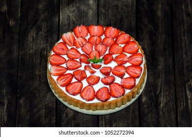 strawberry cake on a wooden background