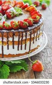 Strawberry cake on a wooden rustic background.