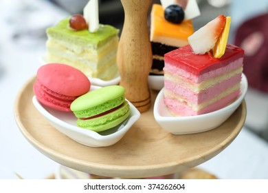 Strawberry cake and two macaron in tea time set