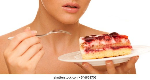 strawberry cake - woman eats sweet dessert isolated