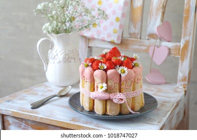 strawberry charlotte with daisies