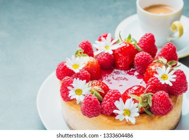 Strawberry Cheesecake Decorated with Fresh Berries copy space.