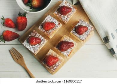 Strawberry Cheeze Cake on wood plate.
