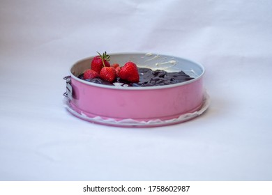 strawberry and chocolate on cake in pink form
