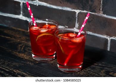 strawberry citrus lemonade on a dark background, horizontal