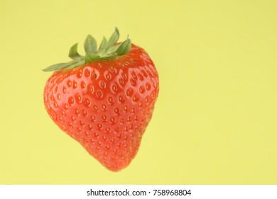 strawberry in closeup on a yellow background