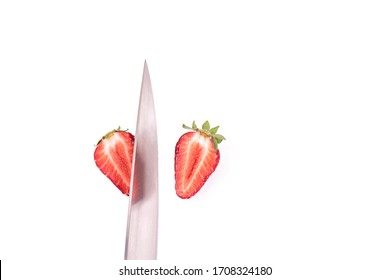 Strawberry closeup sliced with a knife on a white background