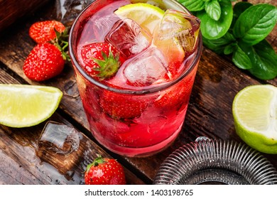 Strawberry cocktail with lime and ice.Ice cold strawberry lemonade