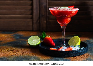 Strawberry cocktail with lime and ice cubes. Space for text. Top view