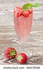 strawberry cooler with fruits in a champagne glass