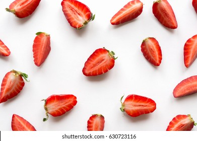 Strawberry creative pattern. Isolated food backdrop. Sliced ripe red berry on white background.