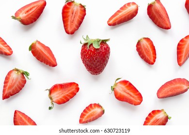 Strawberry creative pattern. Isolated food backdrop. Sliced and whole ripe red berries with green leaves on white background.