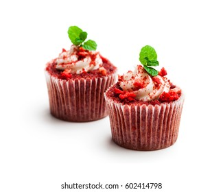 Strawberry  cupcakes with butter cream isolated on white