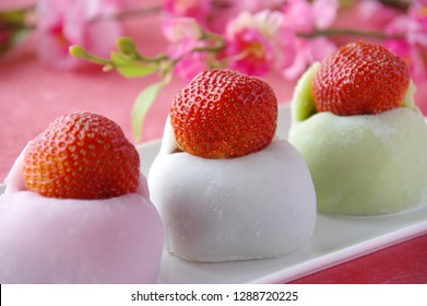 Strawberry Daifuku from pink background,  Japanese confection of a spring image,  Daifuku whose anko contains strawberry