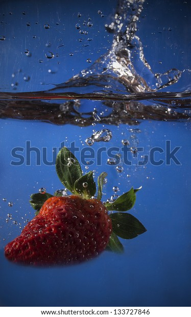 strawberry dipped in water