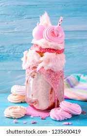 Strawberry freakshake with donuts and candy floss