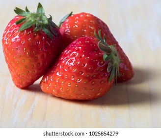 Strawberry fruit on rustic yellow pastel wooden table top