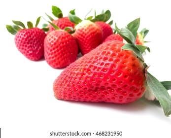 Strawberry fruits on white background.
