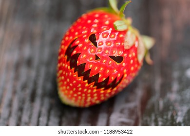 Strawberry with a Halloween face