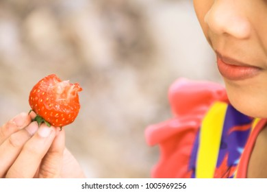 strawberry in hand or eating strawberry