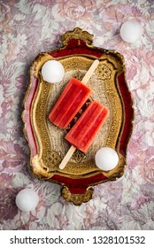 Strawberry ice cream displayed on a vintage tray