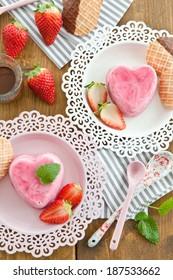 Strawberry ice cream in a heart shape