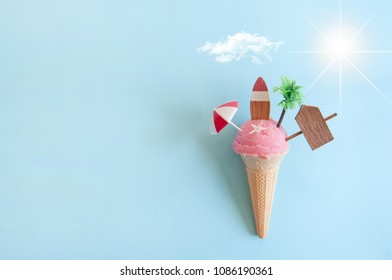 Strawberry icecream with beach items below sun