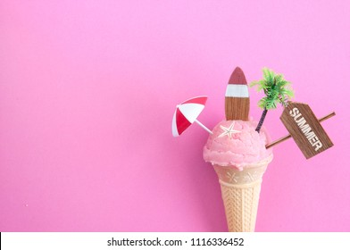 Strawberry icecream with beach sign, parasol, surfboard and pine tree