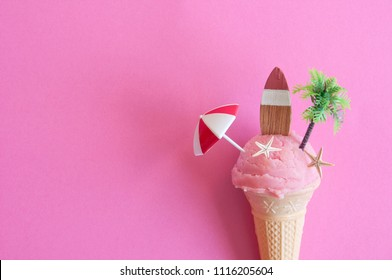 Strawberry icecream with parasol, surfboard and pine tree