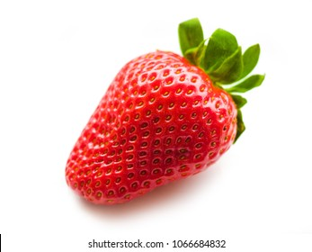 Strawberry isolated on white. Big Close Up of a Fresh Picked Vine Ripened Strawberry on a white background,