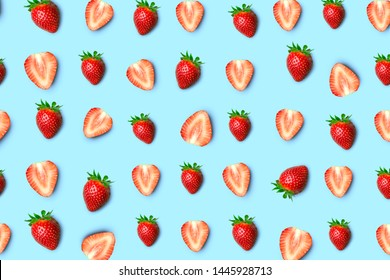 Strawberry isolated. Pattern of strawberrys on colored background. Fresh natural strawberry cut into pieces. Strawberry of different shapes
