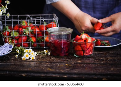 Strawberry jam and strawberry box. Preparing strawberry marmalade