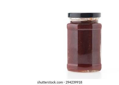 Strawberry jam jar isolated on white background