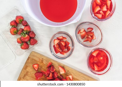 Strawberry Jelly Preparation Process. Homemade Strawberry Jelly with fresh Sliced Strawberries, Top View on White Background