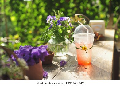 Strawberry juice mixed with soda in garden.