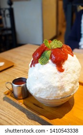 Strawberry kakigori (Bingsu) - Japanese shaved ice dessert flavor, stuffed with cheesecake, topped with strawberry jam, Traditional summer dessert in Japan.