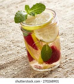 Strawberry lemon water in mason jar