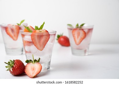 Strawberry lemonade with ice.Cold strawberry soda refreshing drink,Fresh summer cocktail.Glass of strawberry soda drink on white background.