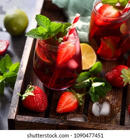 Strawberry lemonade, refreshing summer drink with strawberries, lime and mint, square image