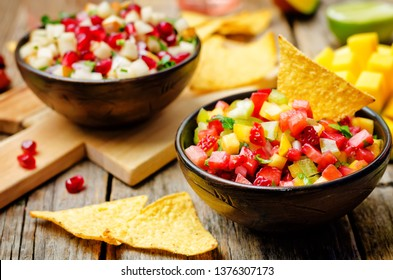 strawberry mango pepper and pomegranate pear salsa. toning. selective focus