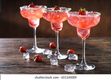 Strawberry Margarita cocktai in wooden back ground
