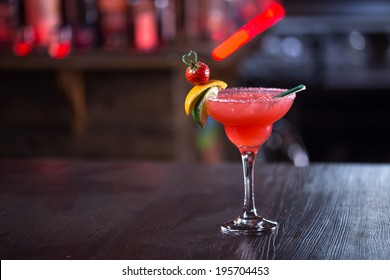 Strawberry margarita cocktail on the bar