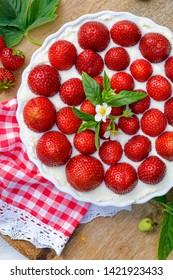 Strawberry mascarpone tart, no bake Tart with mascarpone cream and fresh strawberries, top view. Homemade, summer, simple dessert