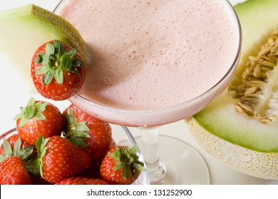 Strawberry and melon cocktail with fruits on the side